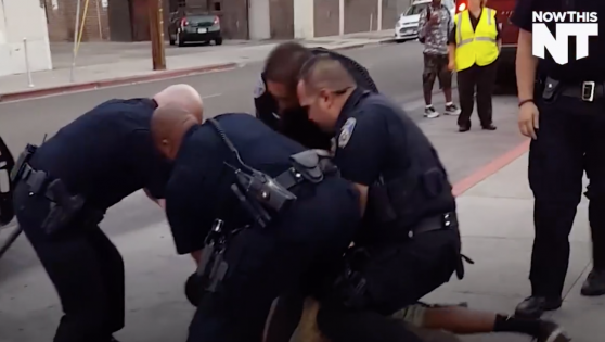 4 cops slam a kid down on the sidewalk for jay walking