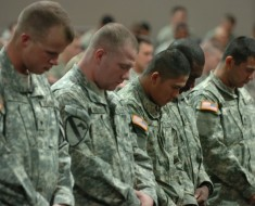 112706-A-1862S-002Soldiers take a moment to pray for Staff Sgt. Daniel Morris at his memorial held at Salie Gym, Forward Operating Base Warhorse, Nov. 27.  Morris died of wounds received in combat on Nov. 25.  He is survived by his family and his daughter Alxys.  (U.S. Army photo by Spc. Ryan Stroud, 3rd Brigade Combat Team, 1st Cavalry Division Public Affairs)