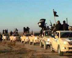 "FILE - In this undated file photo released by a militant website, which has been verified and is consistent with other AP reporting, militants of the Islamic State group hold up their weapons and wave its flags on their vehicles in a convoy on a road leading to Iraq, while riding in Raqqa city in Syria. When world leaders convene for the U.N. General Assembly debate Monday, Sept. 28, 2015, it will be a year since the U.S. president declared the formation of an international coalition to ""degrade and ultimately destroy"" the Islamic State group. Despite billions of dollars spent and thousands of airstrikes, the campaign appears to have made little impact. (Militant website via AP, File)"