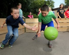 "Fifth graders in Wheaton, Illinois, play a game of gaga ball during recess on Sept. 24, 2015/ The game is a ""kinder, gentler"" version of dodgeball. (Antonio Perez/Chicago Tribune/TNS)"