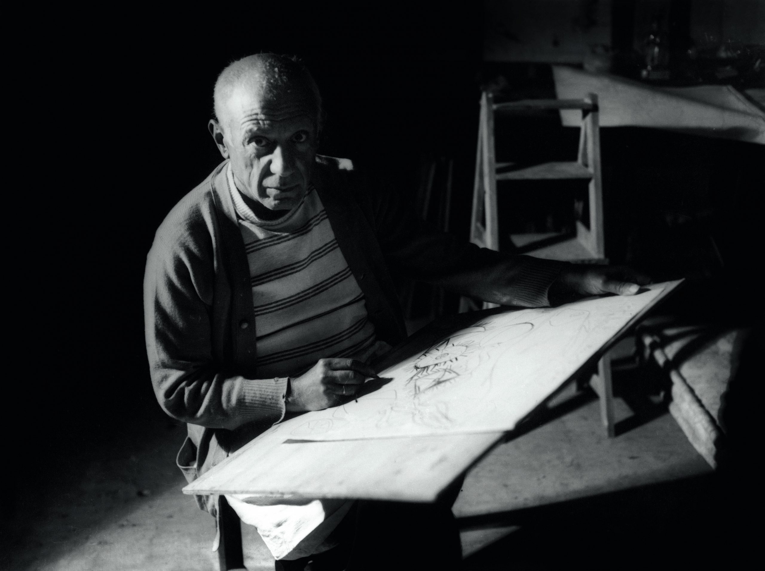Pablo Picasso drawing in Antibes , summer 1946
